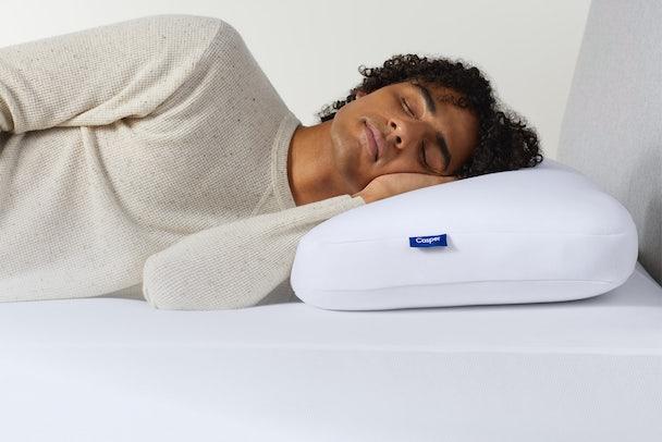 Man resting head on pillow