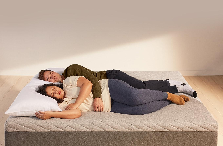 Couple sleeping on Casper Wave mattress