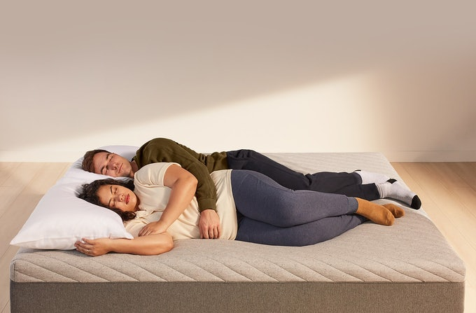 Couple sleeping on Casper Wave mattress
