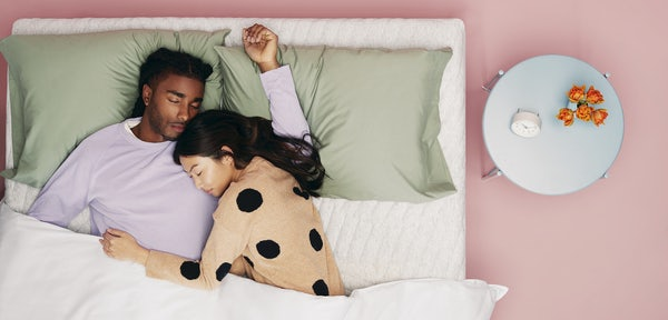 Couple sleeping on Casper mattress