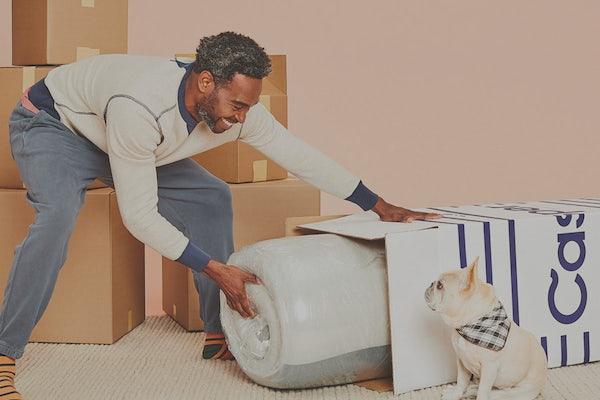 Man unboxing Casper mattress