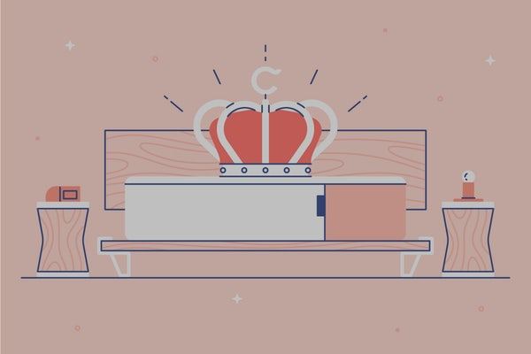 A mattress with a large crown resting on top. Illustration.