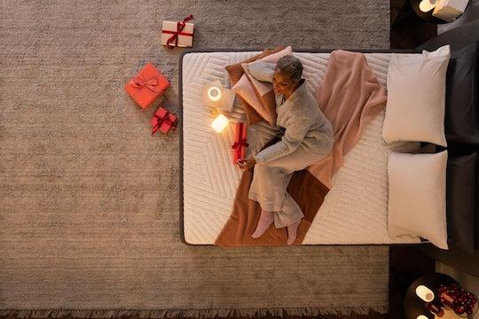 Person lying down comfortably on a Casper mattress