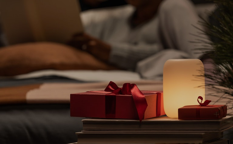 Red gift next to Casper Glow Light