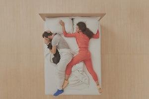 Woman and man sleeping on Casper mattress