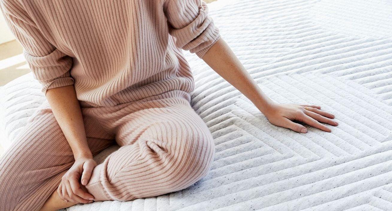 Person sitting on Casper mattress