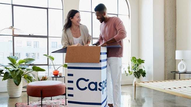 Couple unboxing their new Casper mattress