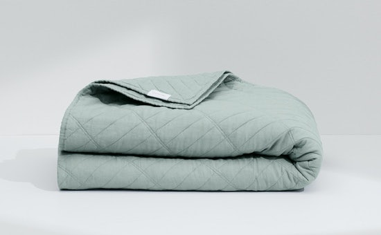 Folded mint airy linen quilt