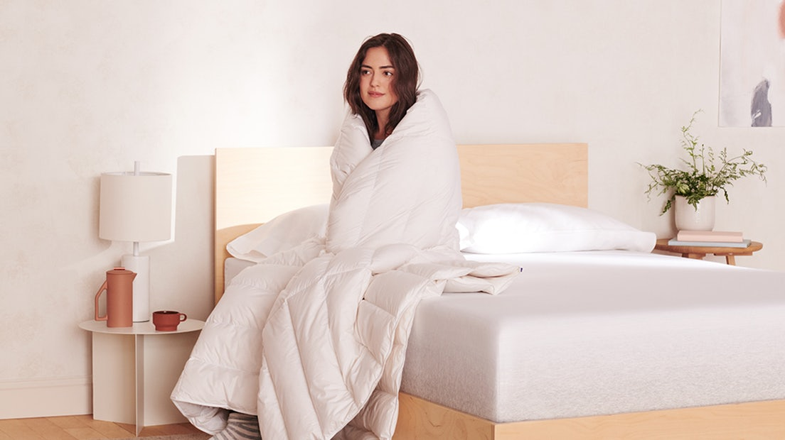 Person wrapped in a Casper down alternative duvet