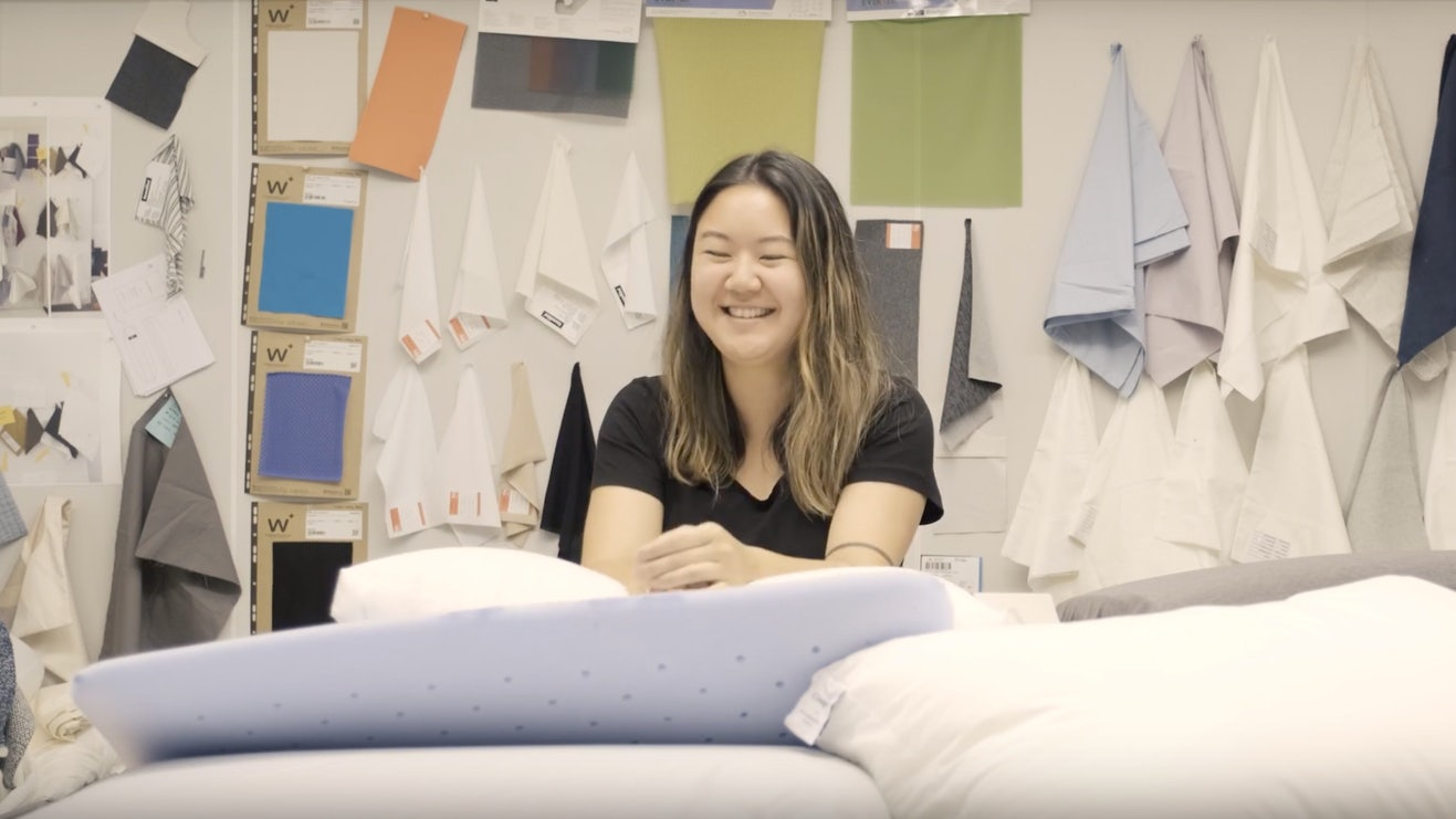 a smiling woman surrounded by Casper pillows
