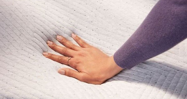 original hybrid mattress with hand pushing down