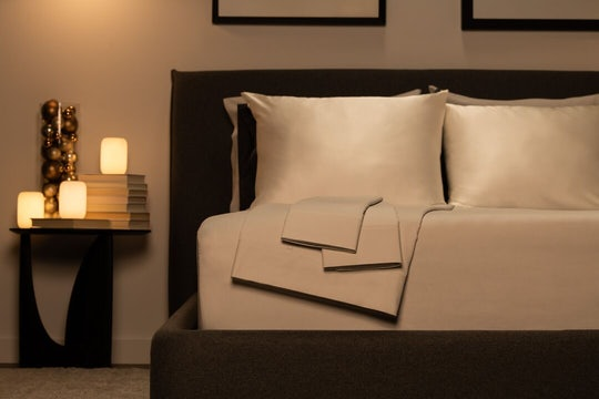 Picture of Casper bed frame, mattress, pillow, sheets, and glow lights.