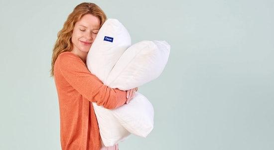 Woman hugging two Casper original pillows