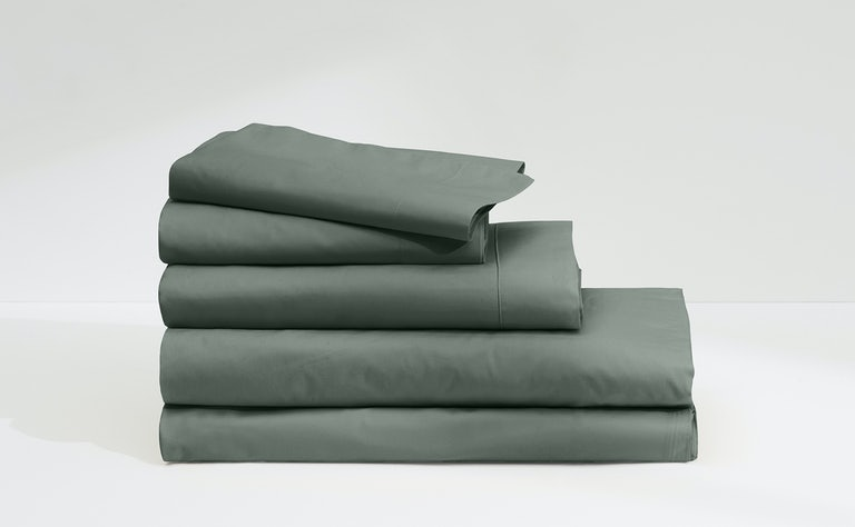 Flat lay of sateen sheets in various colors