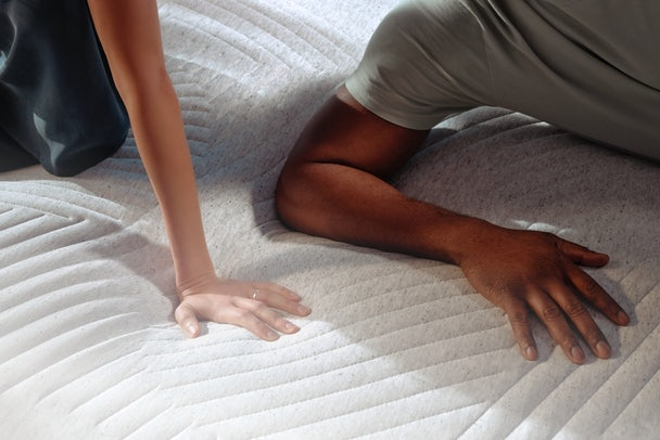 Couple lying on Wave Mattress