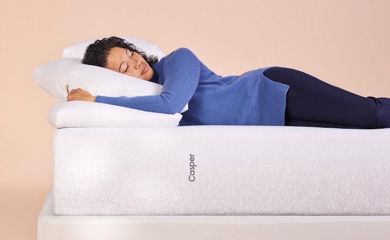 Woman sleeping on Casper Wave mattress