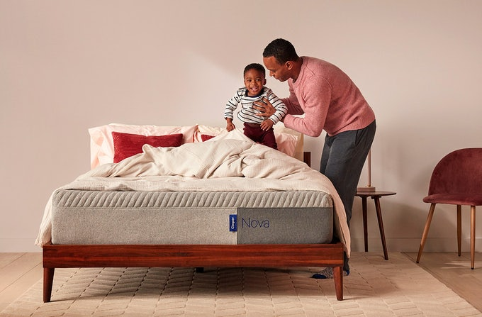 Father helping son on Casper Nova Foam mattress